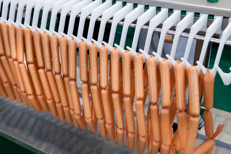 Download Meat Sausages On Plastic Conveyer In Food Industry Stock Photography - Image: 21034292