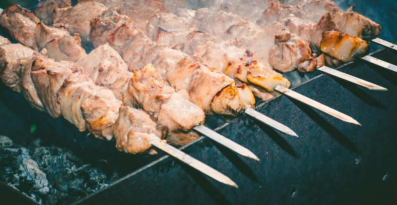 Meat skewer with onion on the skewers on the grill at the stake royalty free stock photography