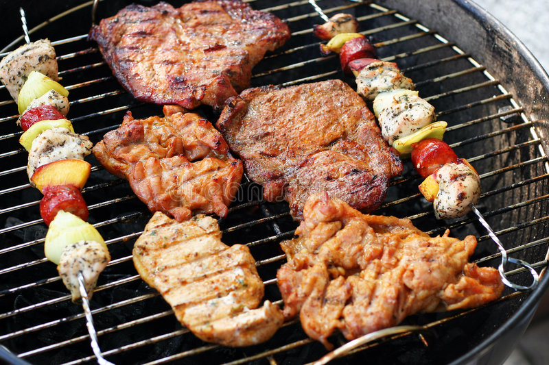 Meat and skewers on the grill stock photo