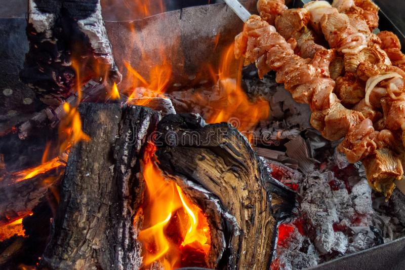Meat skewers grill. Pork or beef are fried on open fire. Barbecue kitchen party close up image. Kebab or shashlik cooking on spits royalty free stock images