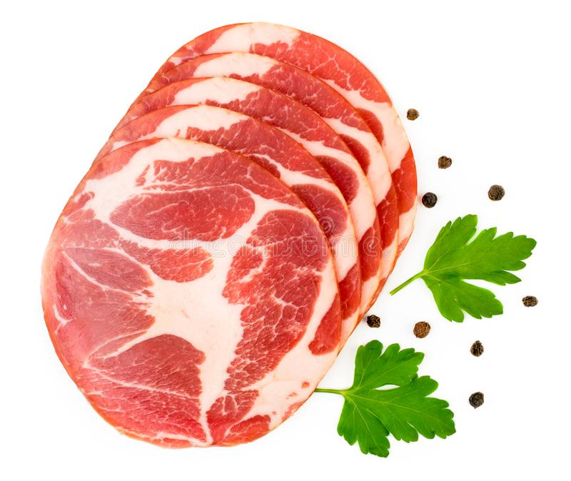 Meat sliced pork with parsley leaves and pepper on a white. The form of the top. royalty free stock photos