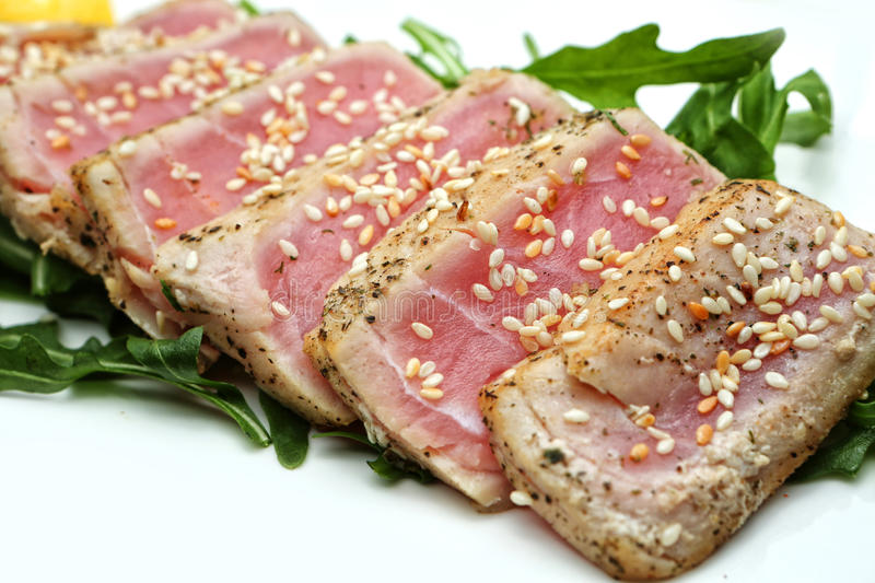 Meat slices tuna with sesame seeds stock photos