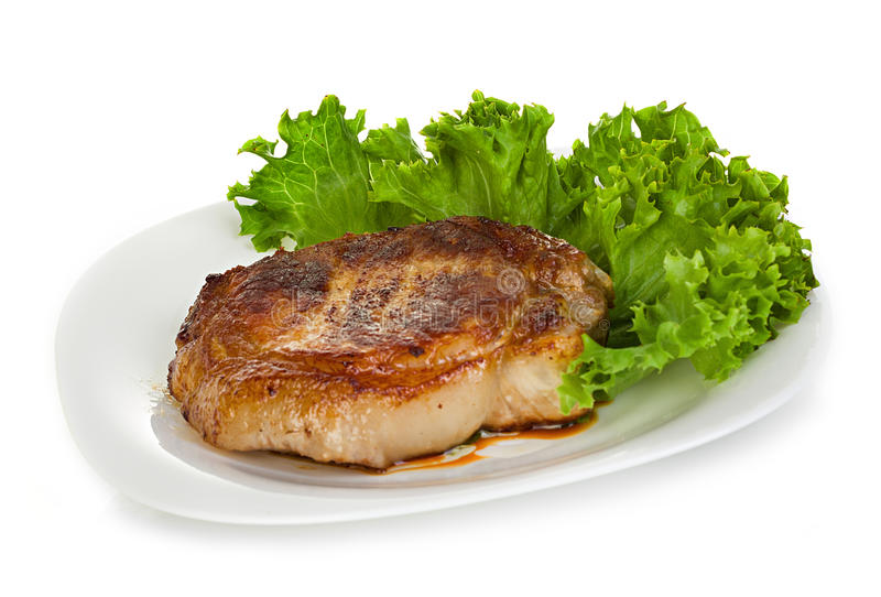 Meat steak with lettuce isolated on white royalty free stock photography