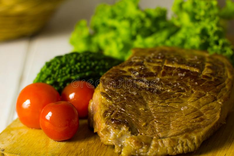 Meat and vegetable steaks stock photography