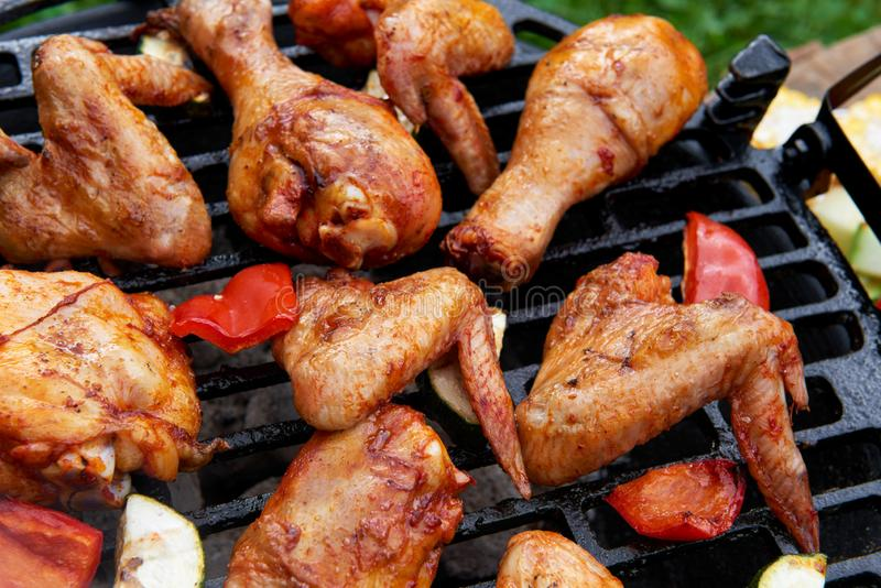 Meat and vegetables during grilling stock photography