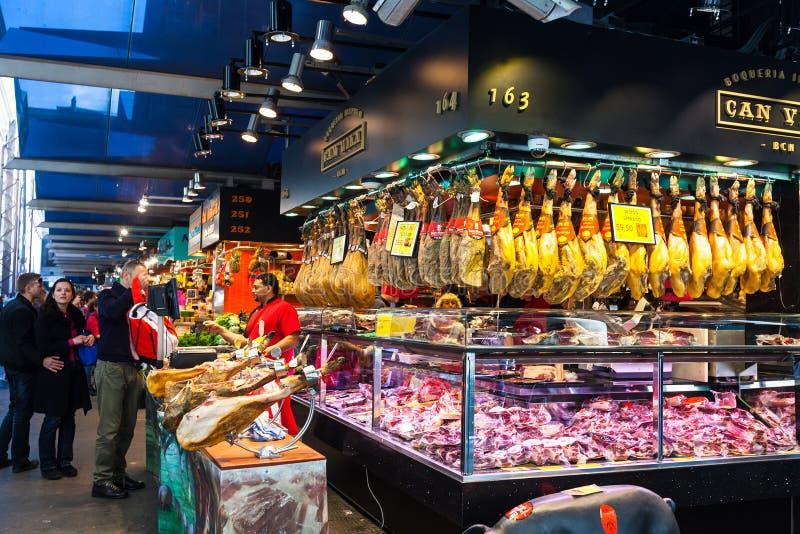 Meat vendor at Boqueria market. Barcelona, Spain. BARCELONA, SPAIN - MARCH 28: meat vendor at Boqueria market in March 28, 2013 in Barcelona, Spain. The market stock photography