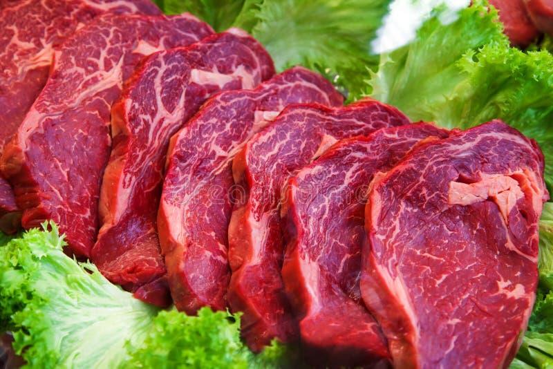 Meat in vetrine. Raw meat in shop vitrine stock image