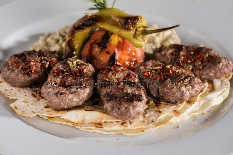 Meatball with garnish. Turkish food stock photography
