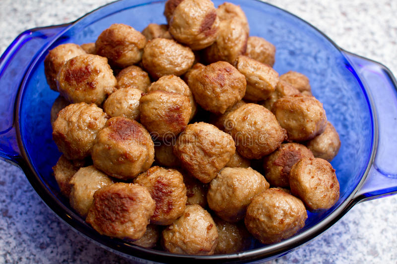 Meatballs. Cooked and ready to serve in a blue casserole dish stock photography