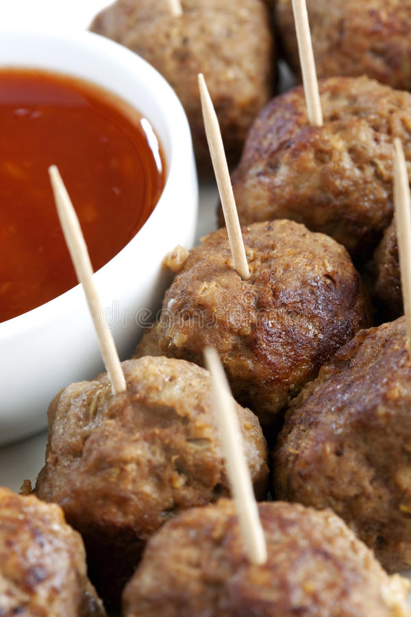 Meatballs Appetiser. A platter of tasty meatballs, with a savory dipping sauce. Perfect party food or appetiser. Selective focus stock images