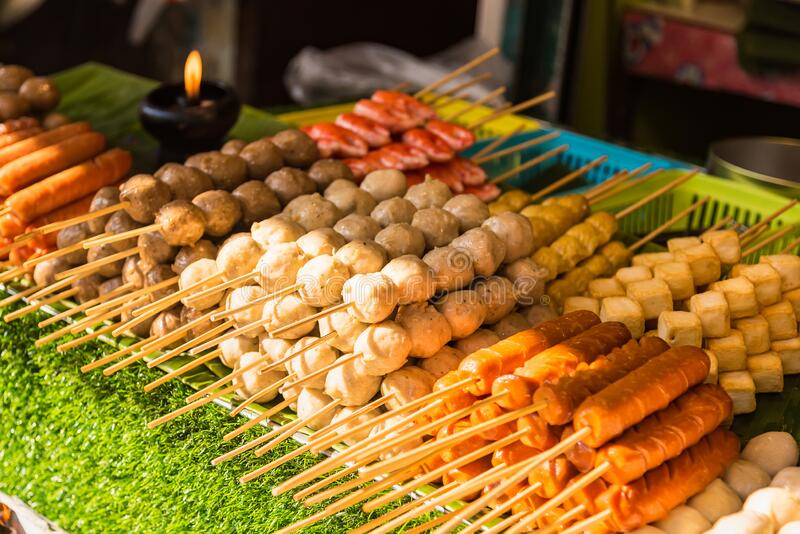 Meatballs with bamboo, wood stick. Traditional Street Food Thailand.  royalty free stock photography