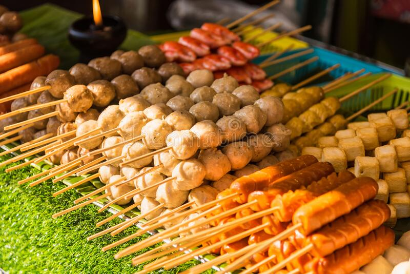 Meatballs with bamboo, wood stick. Traditional Street Food Thailand.  royalty free stock image