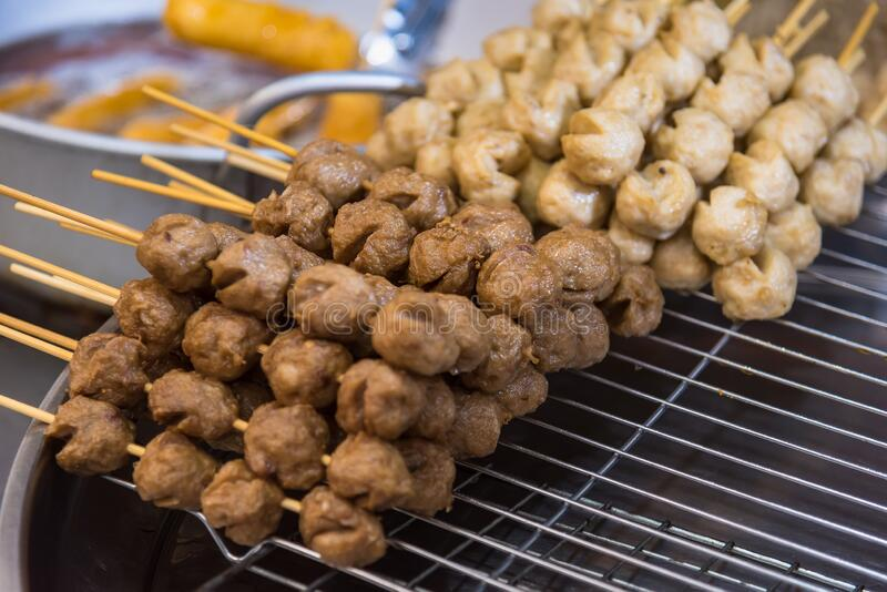Meatballs with bamboo, wood stick. Traditional Street Food Thailand.  stock photo