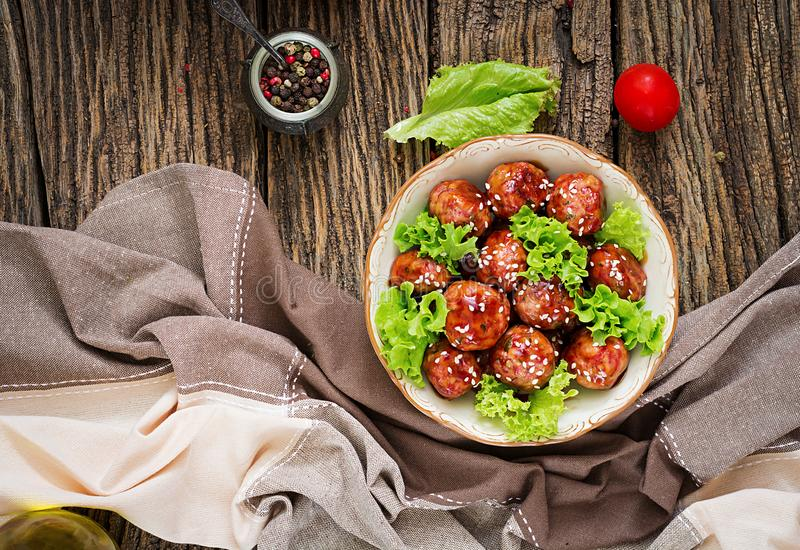 Meatballs with beef in sweet and sour sauce. stock photo