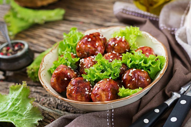 Meatballs with beef in sweet and sour sauce. royalty free stock photos
