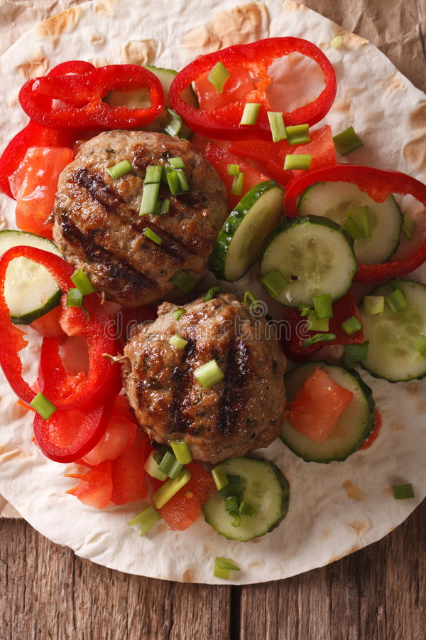 Meatballs with fresh vegetables and Flatbread close-up. vertical stock photo