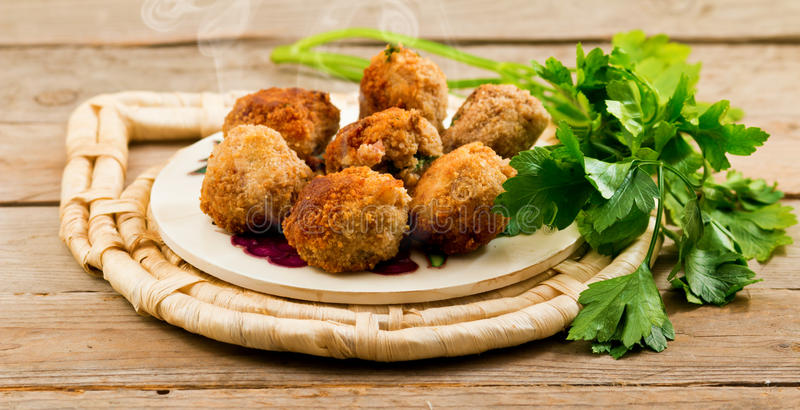 Meatballs and parsley stock image