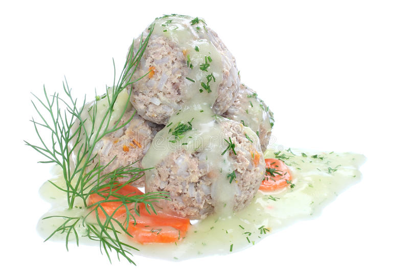 Meatballs of pork and rice. With dill sauce royalty free stock images