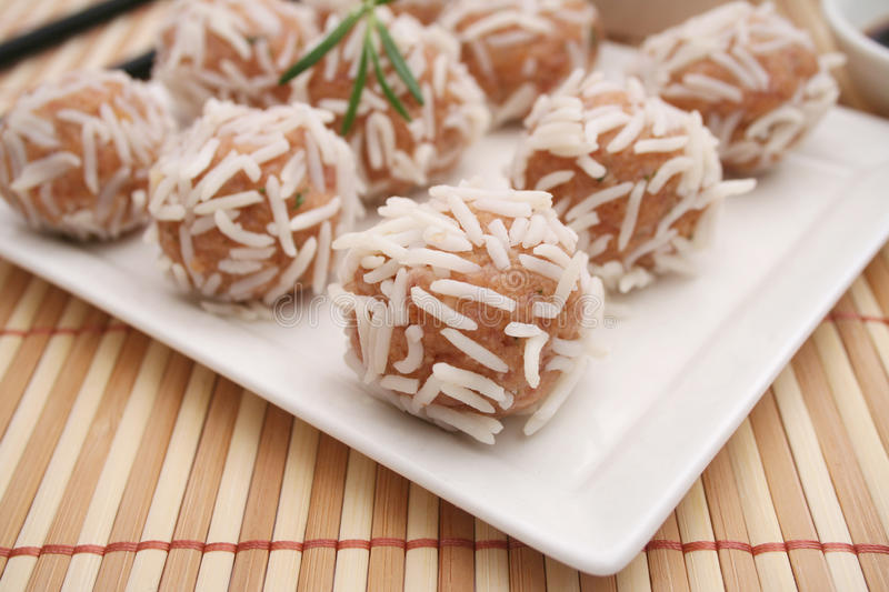 Meatballs with rice. Some fresh asian meatballs with rice royalty free stock photo