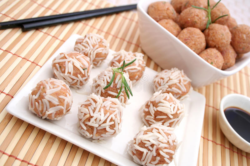 Meatballs with rice. Some fresh asian meatballs with rice stock image