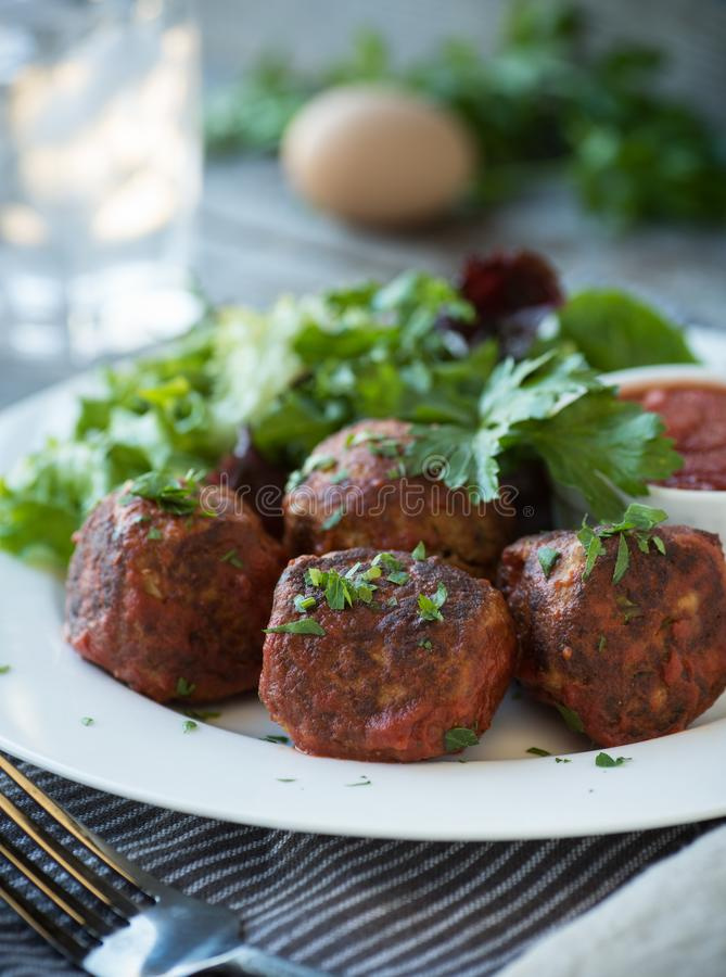 Meatballs and Side Green Salad royalty free stock photo