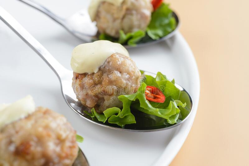 Meatballs with sauce and herbs stock photo