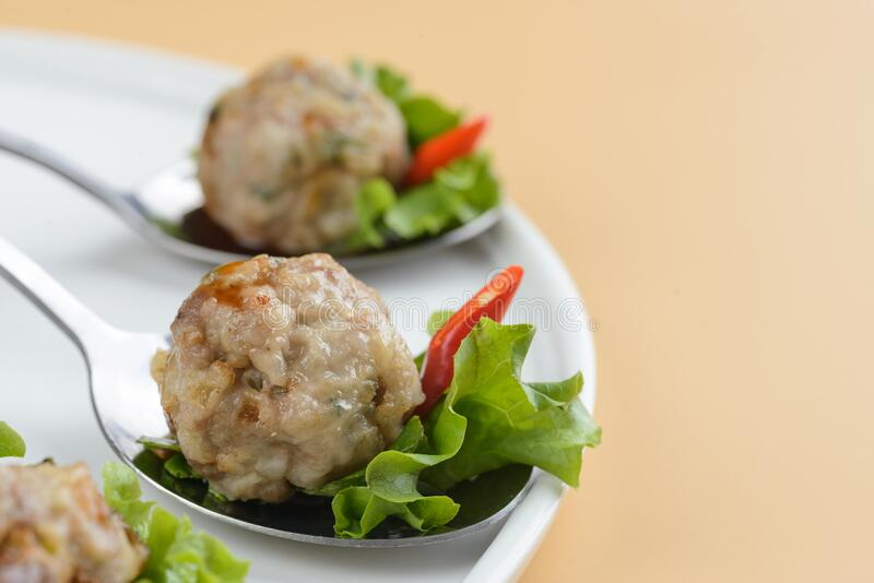 Meatballs with sauce and herbs royalty free stock photos