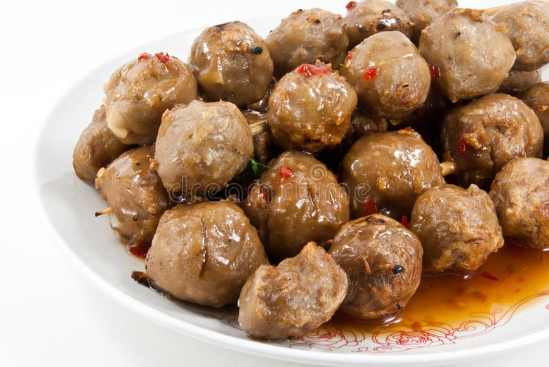 Meatballs with sauce in white dish. Beef meatballs with sauce in white dish stock photos