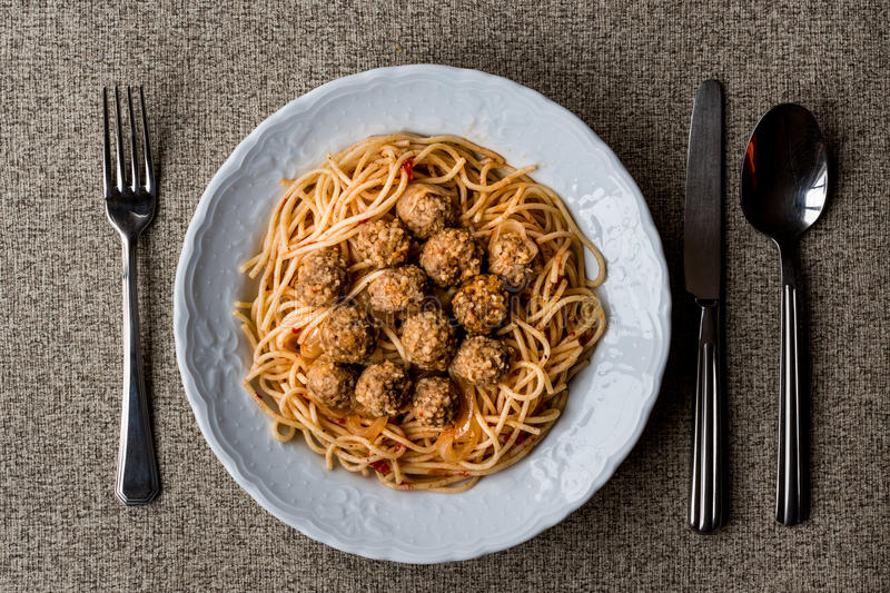 Meatballs with spaghetti bolognese in white plate. royalty free stock photography