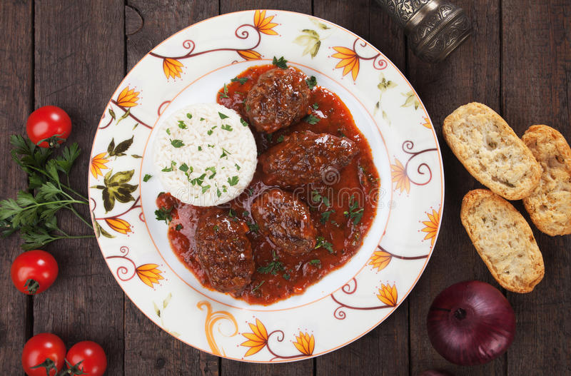 Meatballs in tomato sauce stock image