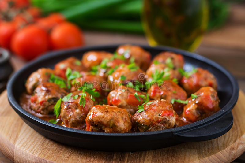 Meatballs in tomato sauce. Meatballs in sweet and sour tomato sauce royalty free stock image