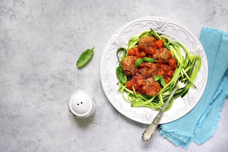 Meatballs with zucchini noodles.Top view. stock image