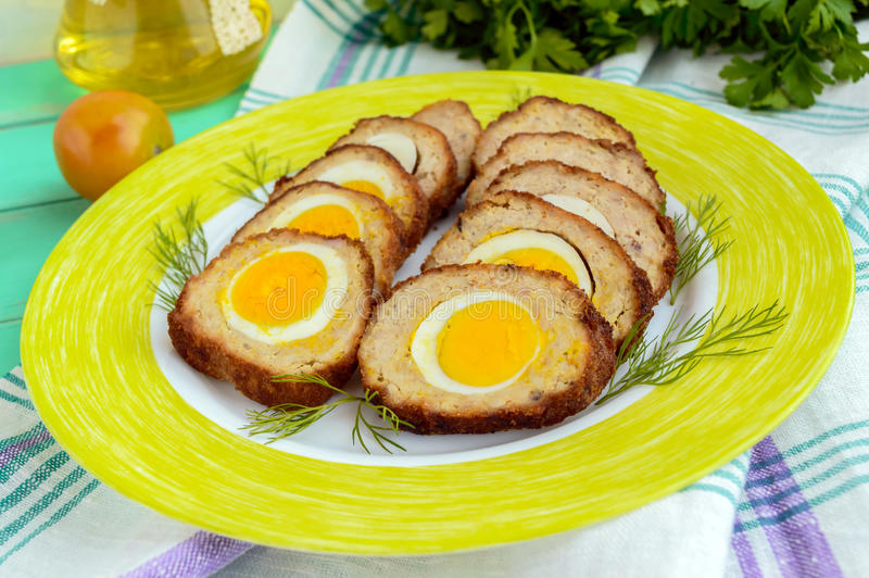Meatloaf stuffed with boiled eggs, sliced. stock images