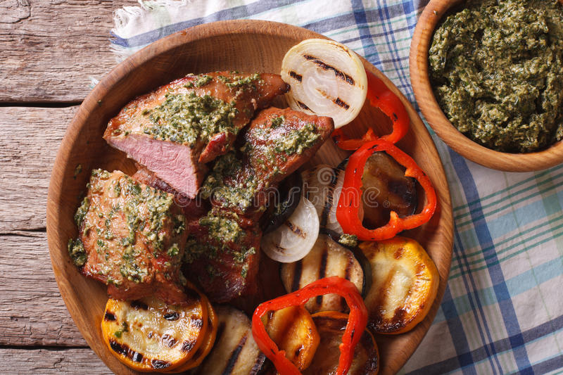 Meats and grilled vegetables with pesto closeup. Horizontal top stock photos