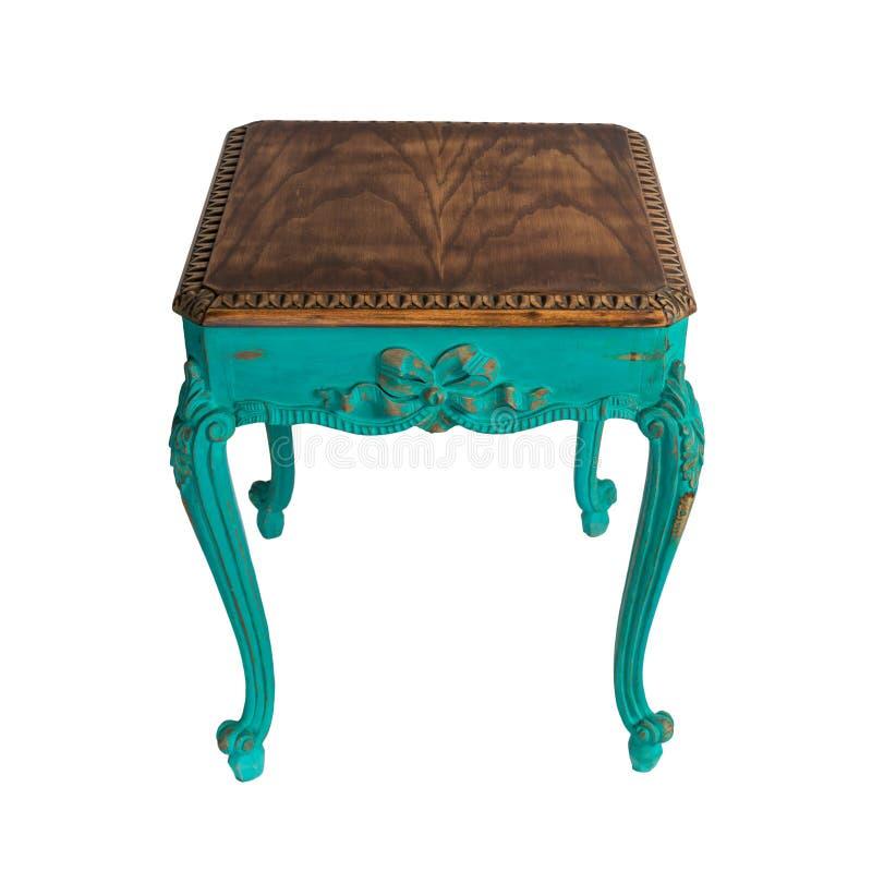Meble retro - drewniany stół z zielonymi pomalowanymi nogami, wyizolowany ścieżką przycinającą zdjęcie royalty free