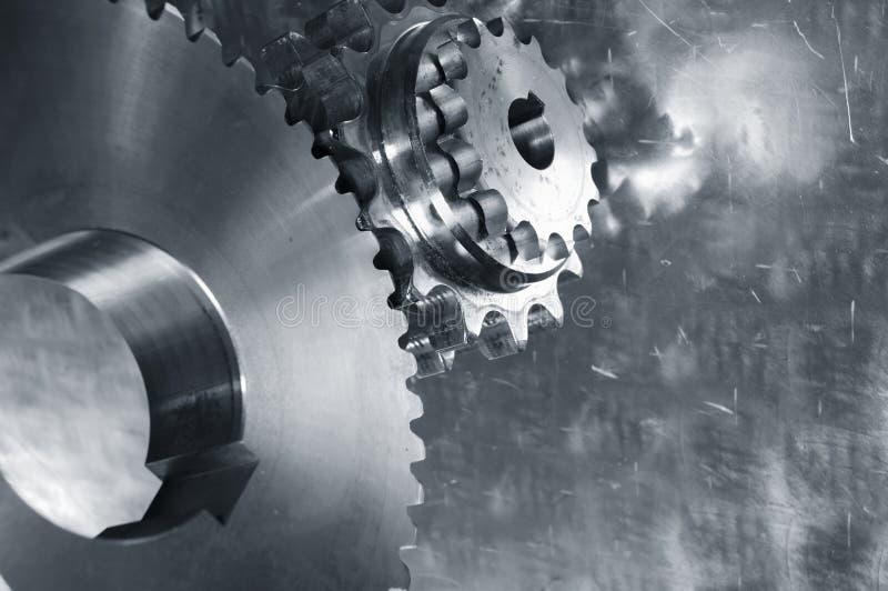 Mecánicos del engranaje en la acción fotos de archivo