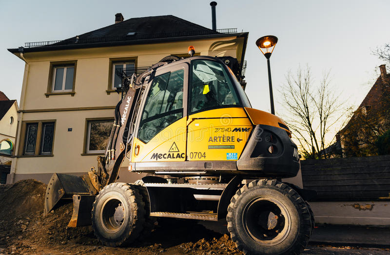Download Mecalac Excavator Illuminated At Night On Street Editorial Stock Photo - Image: 83720888