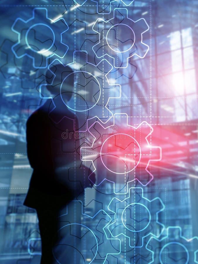 Mecanismo de engranajes de la exposición doble en fondo borroso Concepto de la automatización del negocio y del proceso industria imágenes de archivo libres de regalías