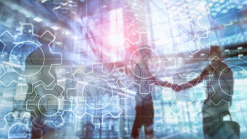 Mecanismo de engrenagens da exposição dobro no fundo borrado Conceito da automatização do negócio e de processo industrial ilustração stock