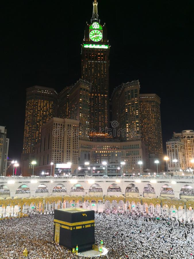Kaaba and Mecca clock tower - Kaaba. Mecca, Saudi Arabia - August 12, 2018 - Kaaba and Mecca`s clock tower - Kaaba royalty free stock photo