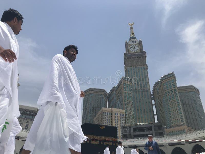 MECCA, SAUDI ARABIA-CIRCA MAY 2019 :Abraj Al Bait Royal Clock Tower Makkah in Makkah, Saudi Arabia while Muslim pilgrims. Circumambulate tawaf the Kaaba royalty free stock photo