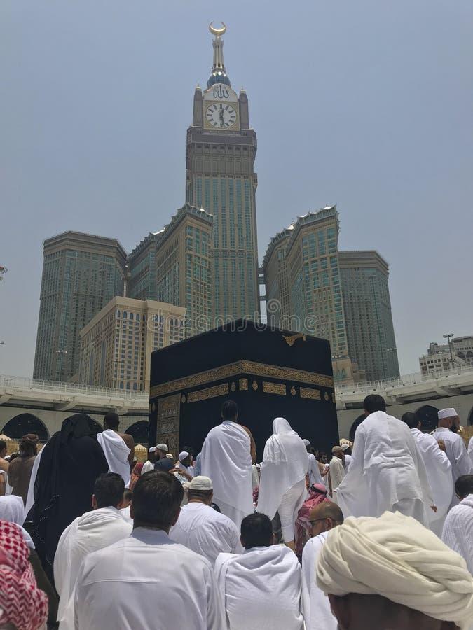 MECCA, SAUDI ARABIA-CIRCA MAY 2019 :Abraj Al Bait Royal Clock Tower Makkah in Makkah, Saudi Arabia while Muslim pilgrims. Circumambulate tawaf the Kaaba stock photography