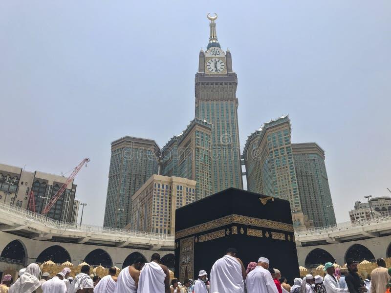 MECCA, SAUDI ARABIA-CIRCA MAY 2019 :Abraj Al Bait Royal Clock Tower Makkah in Makkah, Saudi Arabia while Muslim pilgrims. Circumambulate tawaf the Kaaba royalty free stock photography