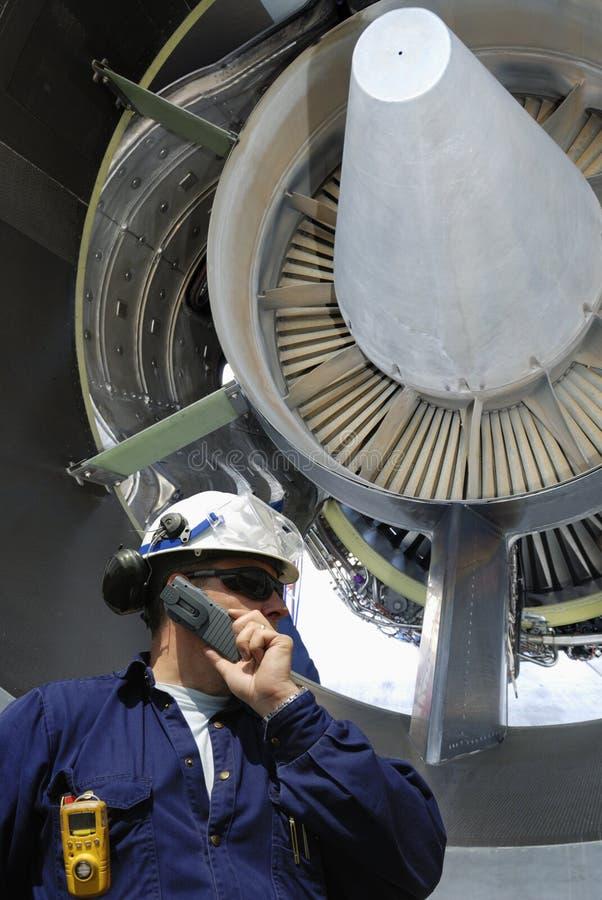 Meccanico e motore a propulsione fotografie stock libere da diritti