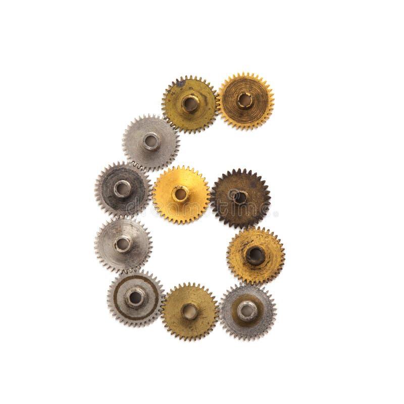 Meccanismi di ingranaggi numerico dei denti dello steampunk della cifra sei Numero di superficie metallico 6 del bronzo struttura immagine stock