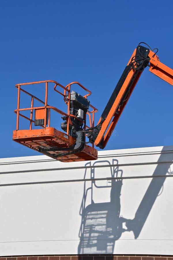Mechancial lift bucket throws it`s shadow stock photos