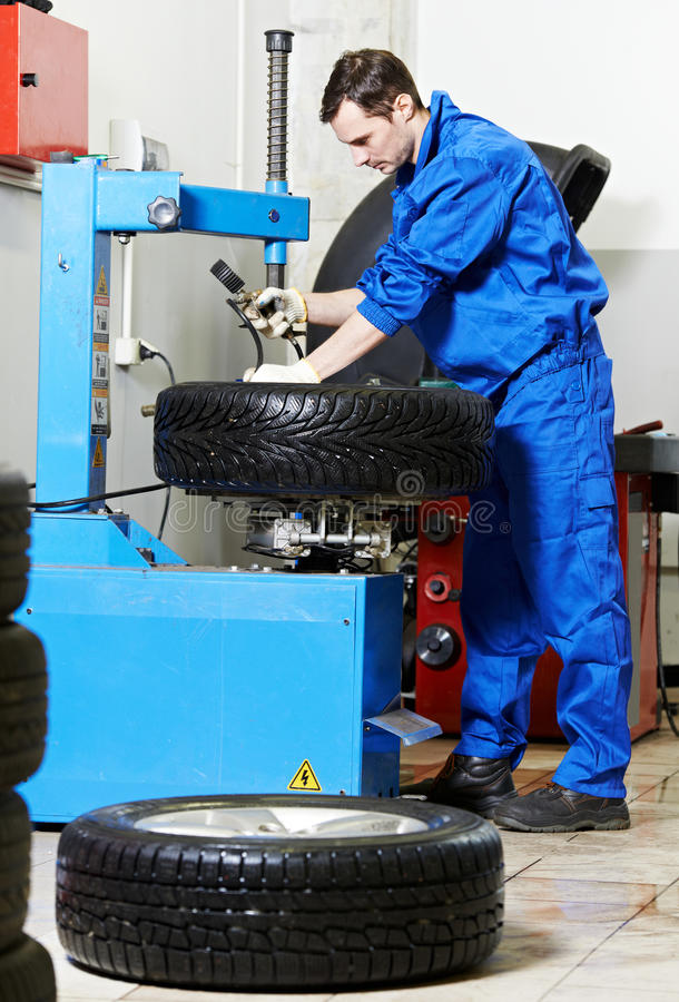 Download Mechanic At Auto Wheel Tyre Changer Stock Photo - Image: 31276730