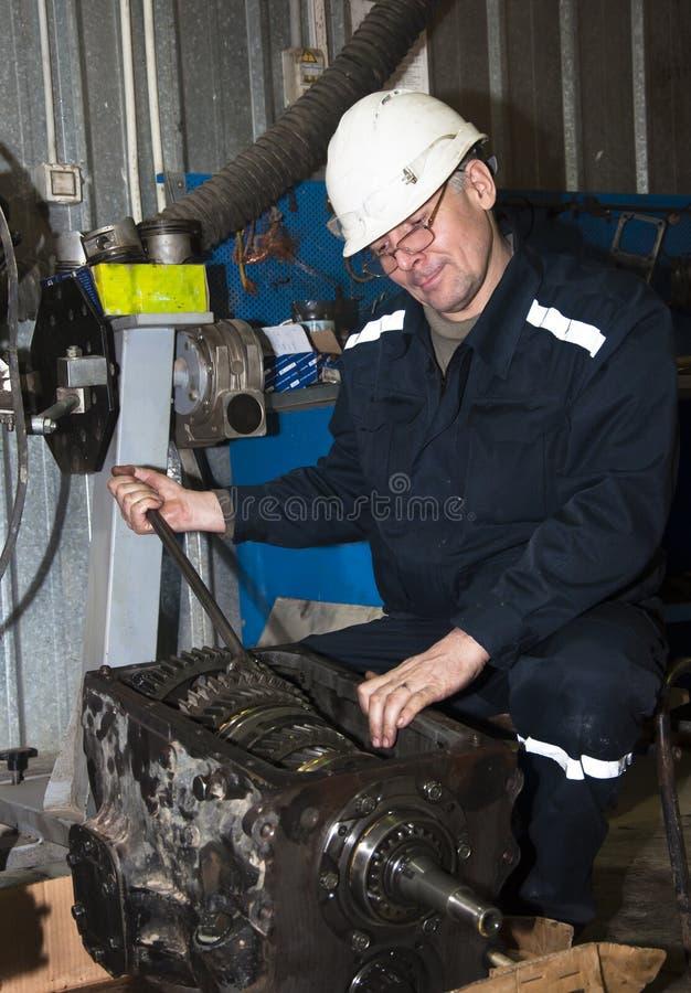 Free Mechanic Behind Work In Garage Stock Photos - 42361033