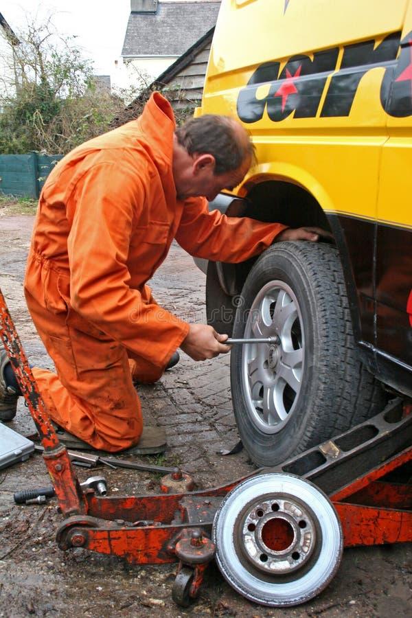 Mechanic changing brake disc. On van stock photo