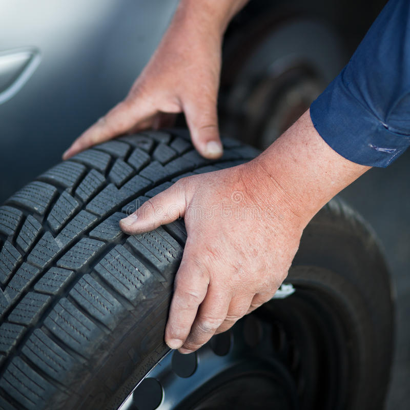 Mechanic Changing A Wheel Of A Modern Car Stock Photography